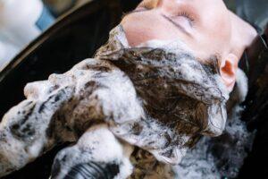 woman-getting-her-hair-shampoo-3993444